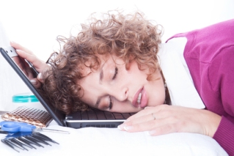 Woman sleeping on laptopat at her working plac